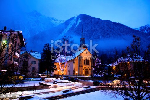 Chamonix town by night with snowy mountains on the background. Chamonix-Mont-Blanc was the site of the first Winter Olympics in 1924 and it's one of the oldest ski resorts in France.