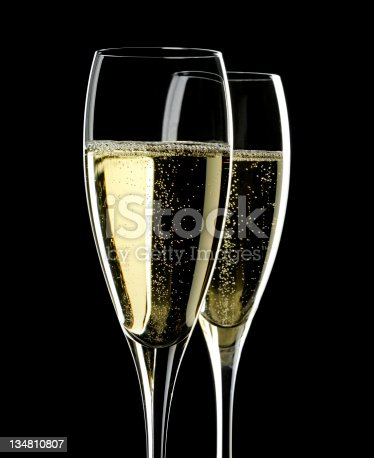 2 Flutes of Champagne on black Background