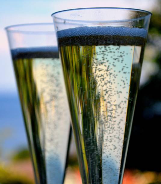 Champagne against sea view stock photo