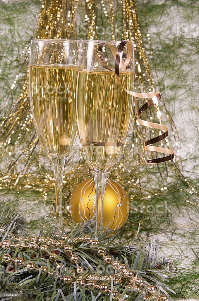Champagne and Christmas ornaments royalty-free stock photo