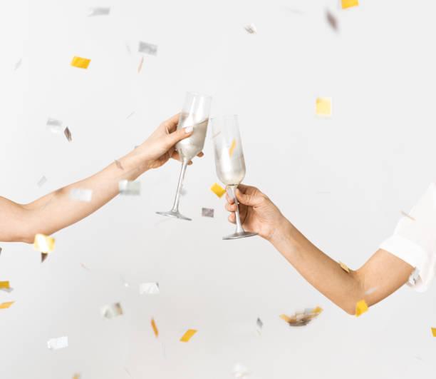 celebração do champanhe e do confetti - brinde - fotografias e filmes do acervo