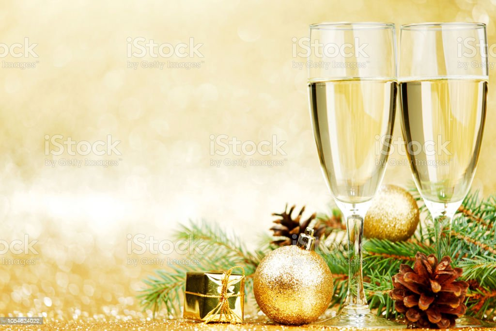 champagne and new year decorations on golden background royalty free stock photo