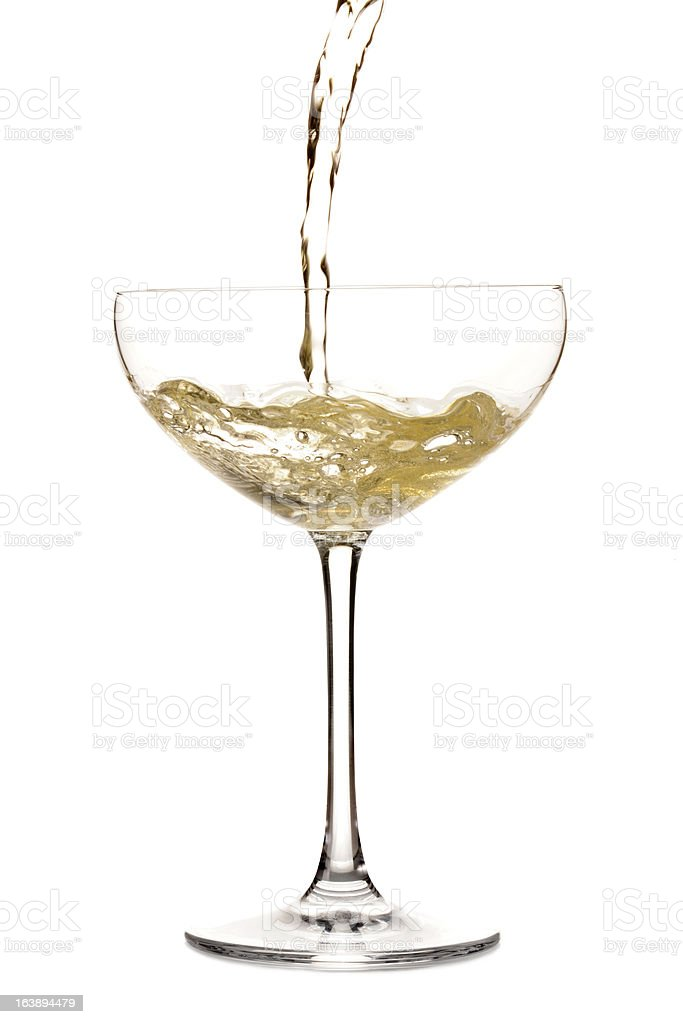 Champagne being poured in a glass stock photo
