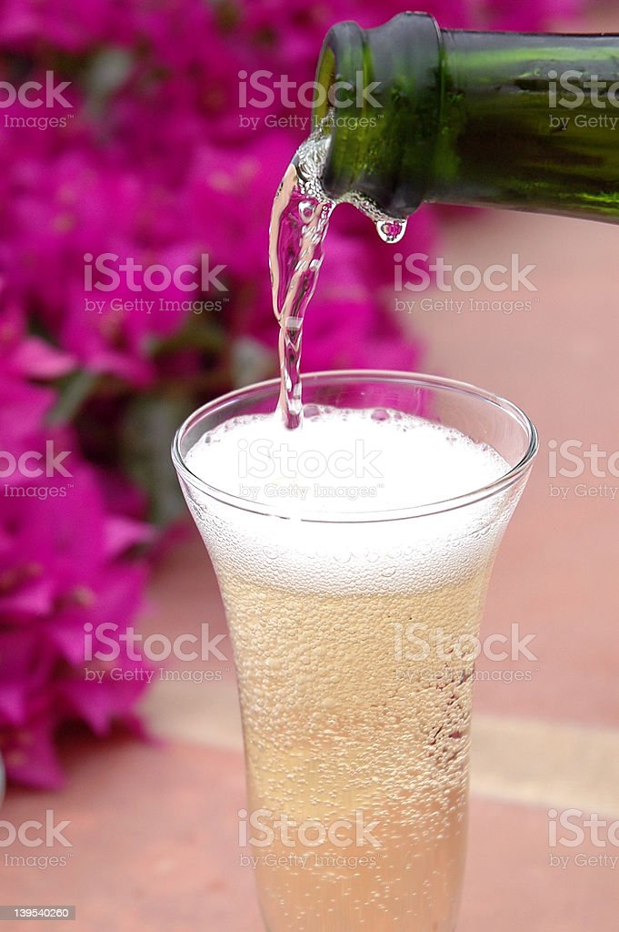 Champagne being poured royalty-free stock photo