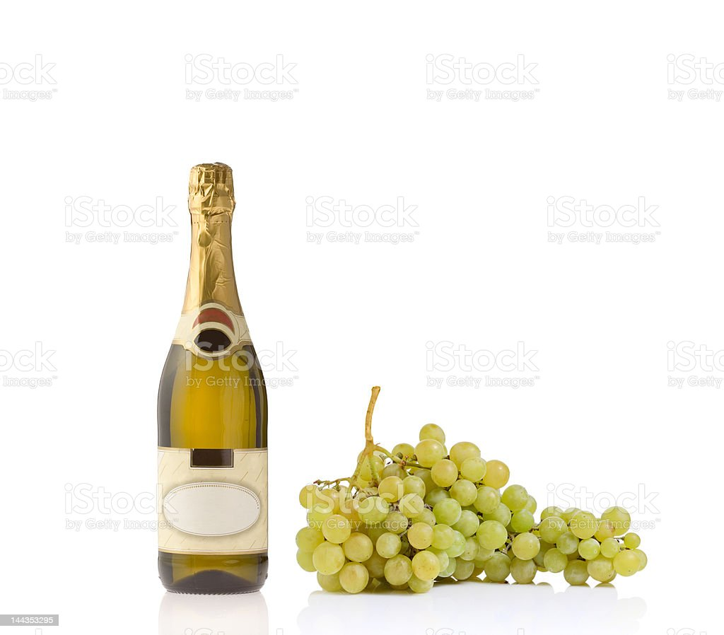 Champagne bottle and grapes stock photo