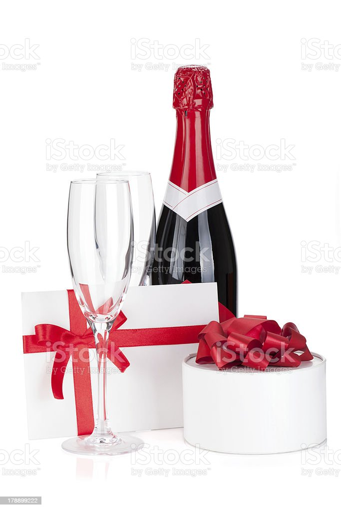 Champagne bottle, glasses and gift royalty-free stock photo