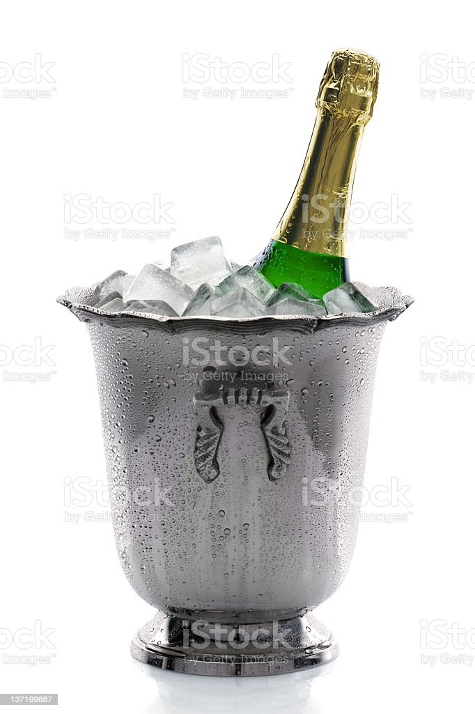 Champagne bottle in a silver bucket with ice stock photo