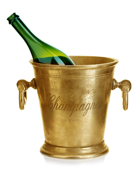 Champagne bottle in ice bucket close-up isolated on a white background. stock photo