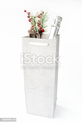 istock Champagne Bottle in Silver Gift Bag with Decoration 636969128