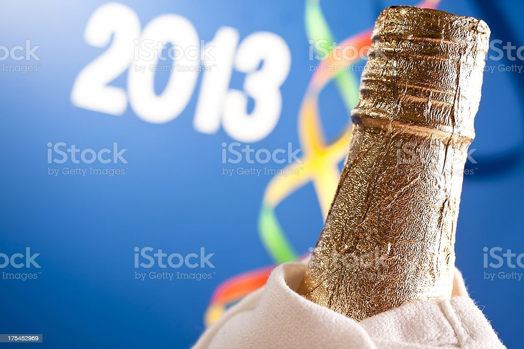 Champagne bottle with 2013 in background. royalty-free stock photo