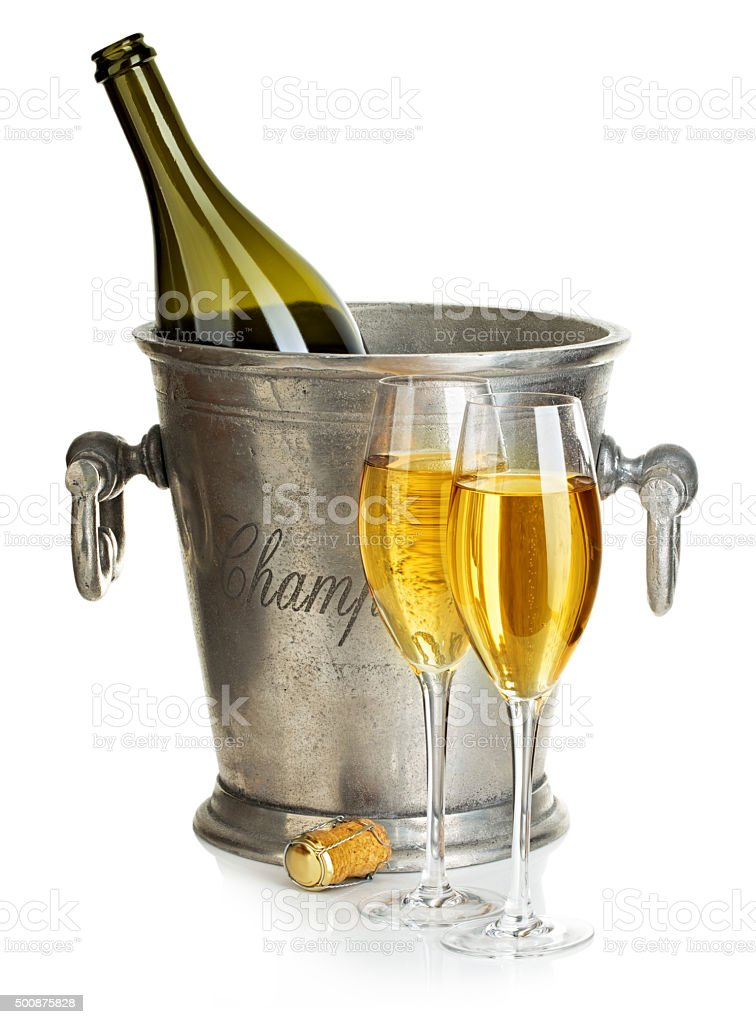 Champagne bottle with bucket ice and glasses of champagne isolated. stock photo