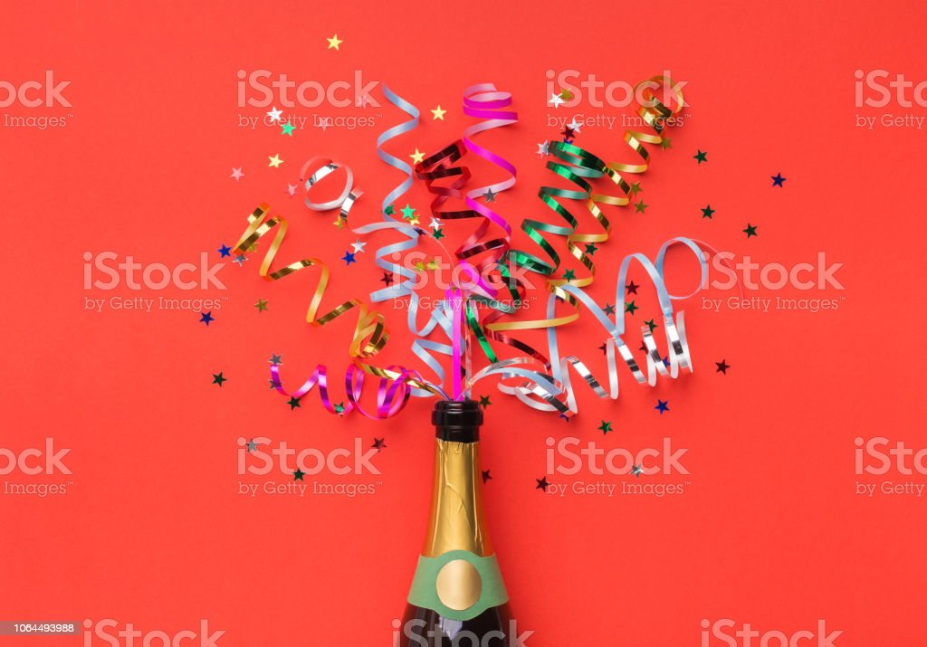 Champagne bottle with colorful streamers top view stock photo