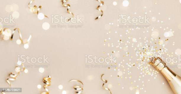 Champagne bottle with confetti stars bokeh decoration and party on picture id1176723521?b=1&k=6&m=1176723521&s=612x612&h=9mffwbmezc8zwcfp7immytnxgvtm0wb4wo1wms9v2qi=