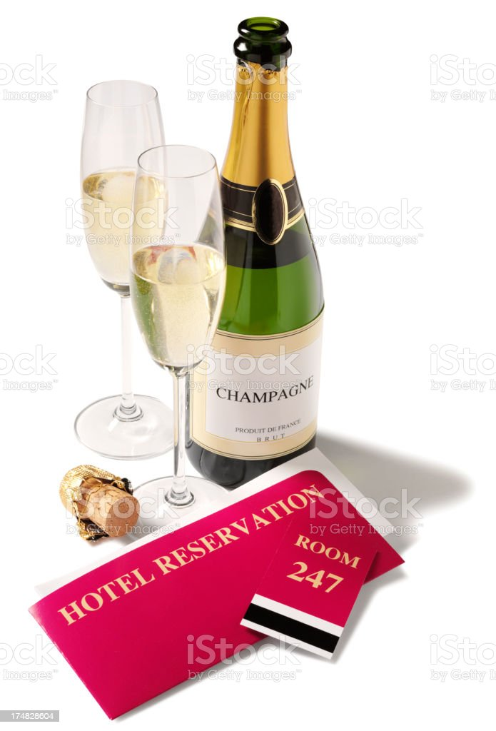 Champagne Bottle with Glasses and a Reservation Ticket stock photo