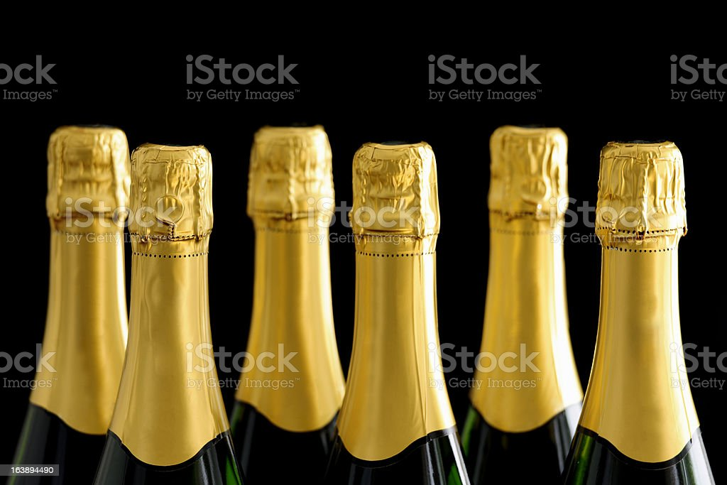 Champagne bottles on black backround stock photo