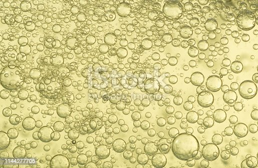 Many small champagne bubbles when filling a crystal glass.
