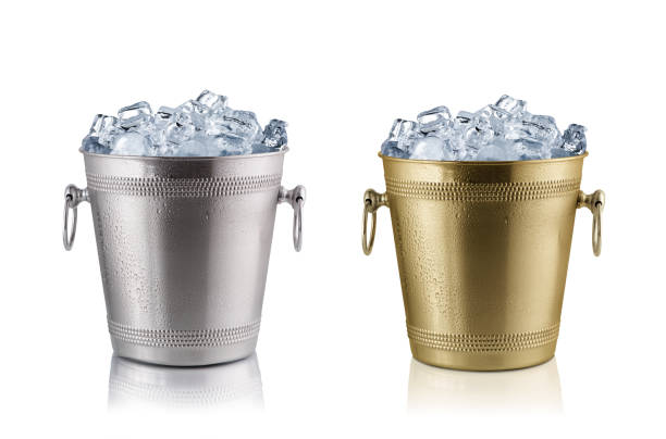 Champagne buckets, full with ice. Isolated on white stock photo