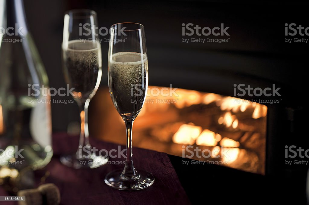 Champagne by the Fire royalty-free stock photo