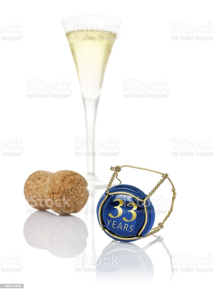 Champagne cap with the inscription 33 years stock photo