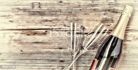 istock Champagne. Champagne bottle and two empty glasses on a wooden background. Valentine's Day. Birthday. Wedding. Anniversary. NEW YEAR Rustic style. 863371238