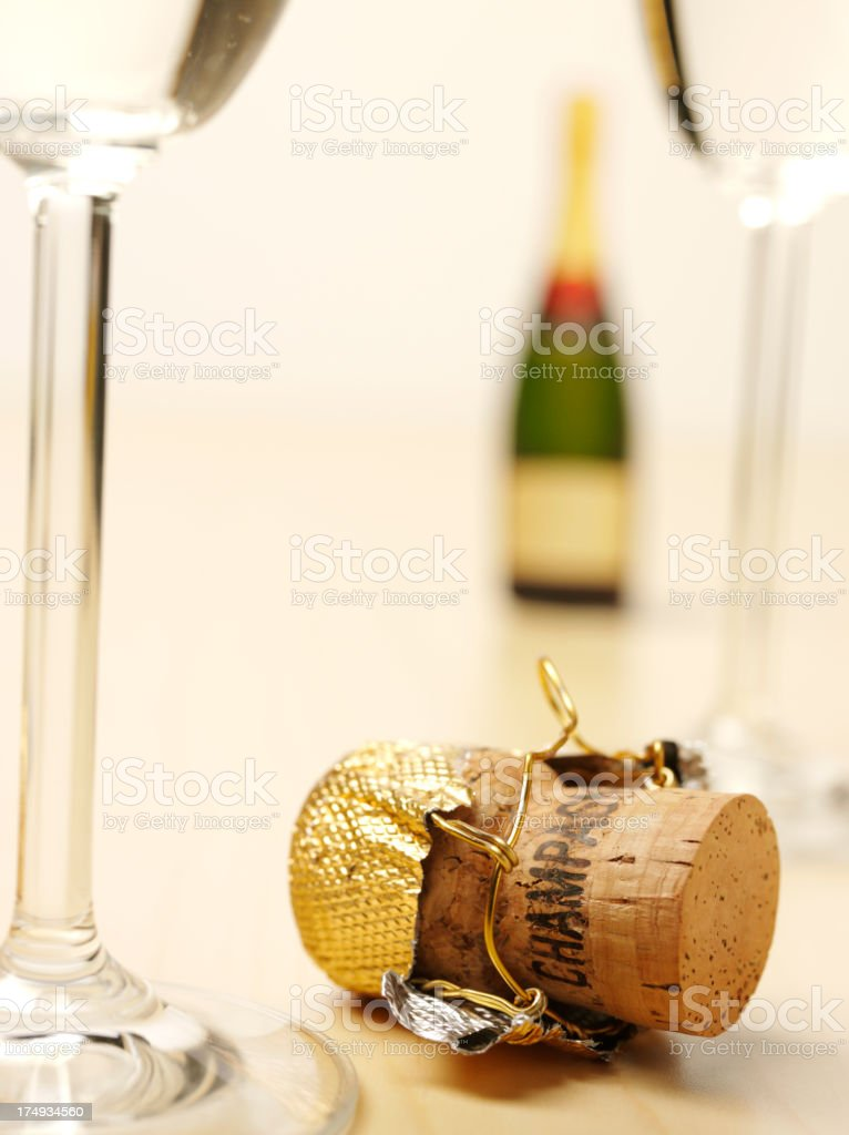 Champagne Cork with a Bottle and Glass Flutes royalty-free stock photo
