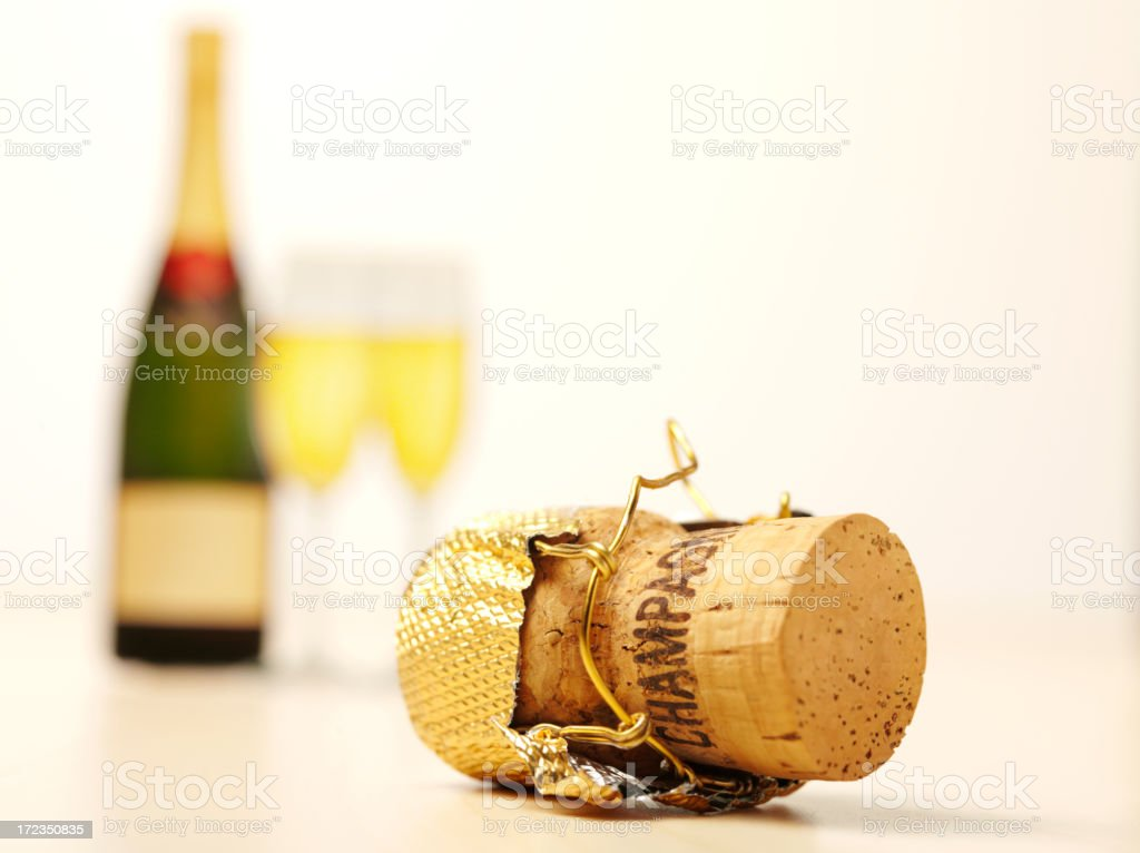 Champagne Cork with a Bottle and Glasses royalty-free stock photo