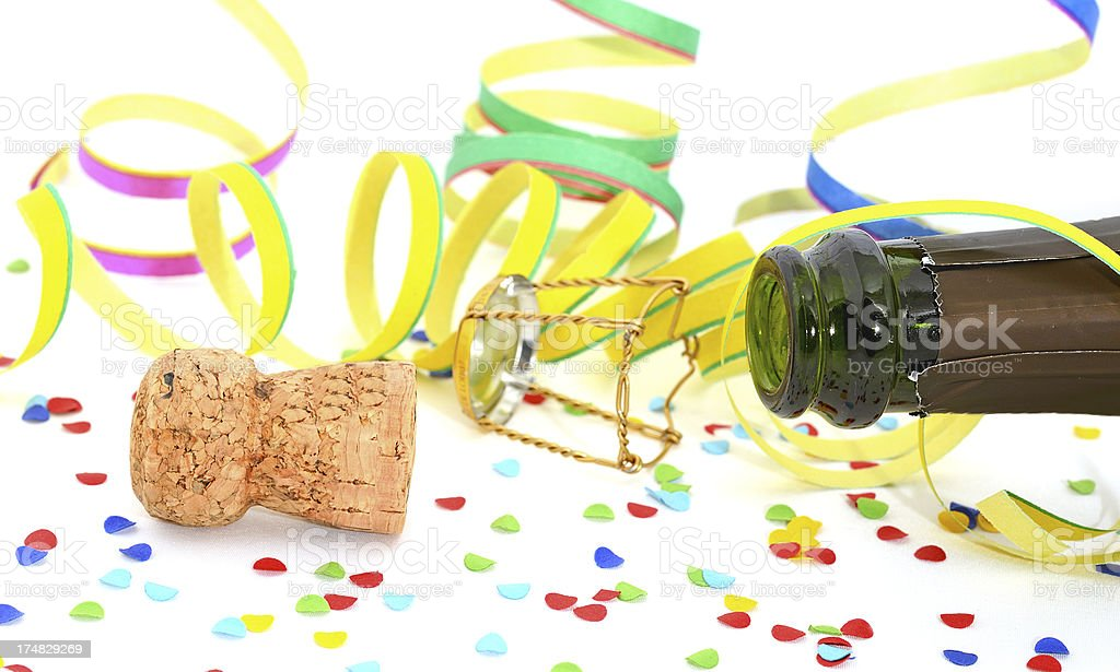 Champagne cork with bottle and confetti on white background royalty-free stock photo