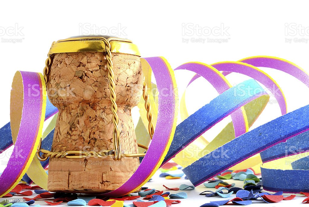 Champagne cork with cap and confetti plus paper streamer royalty-free stock photo