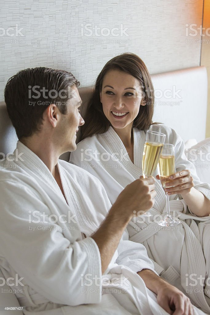 Champagne Couple in Bed royalty-free stock photo