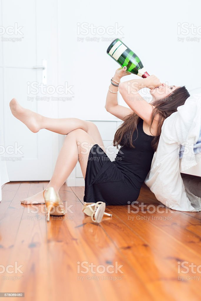 champagne drinking women in bedroom stock photo