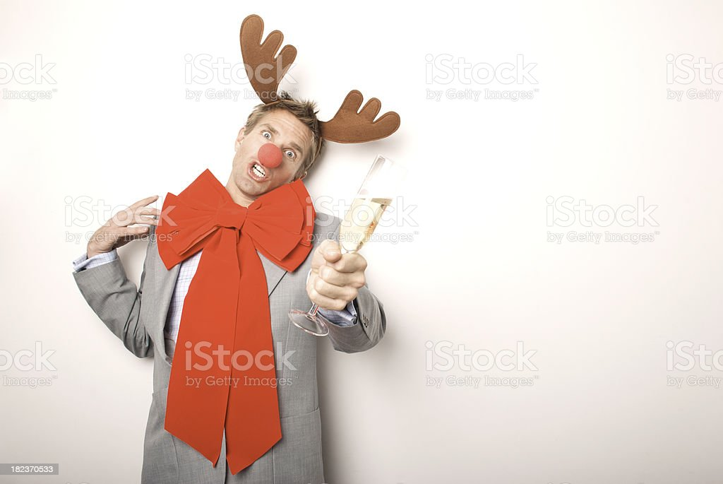 Champagne Drunk Reindeer Businessman in Headlights at Office Party royalty-free stock photo