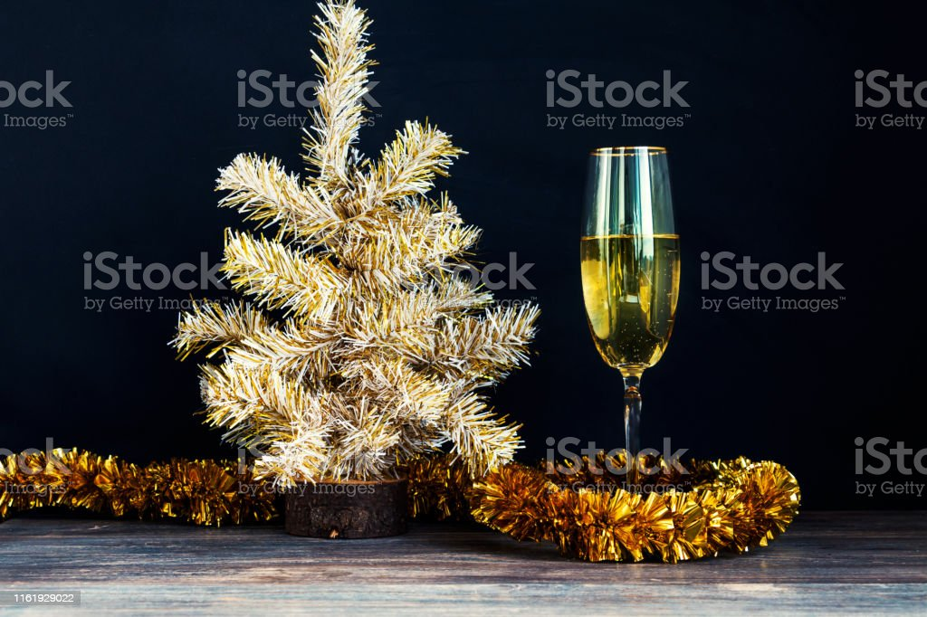 Champagne flute and christmas silver and gold decorations -...