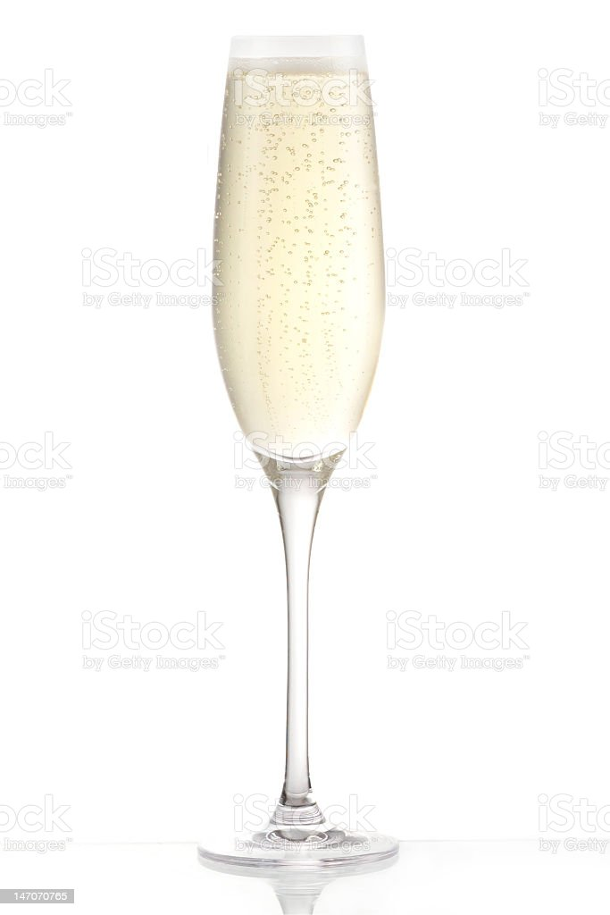 Champagne flute of sparkling white wine on white background stock photo