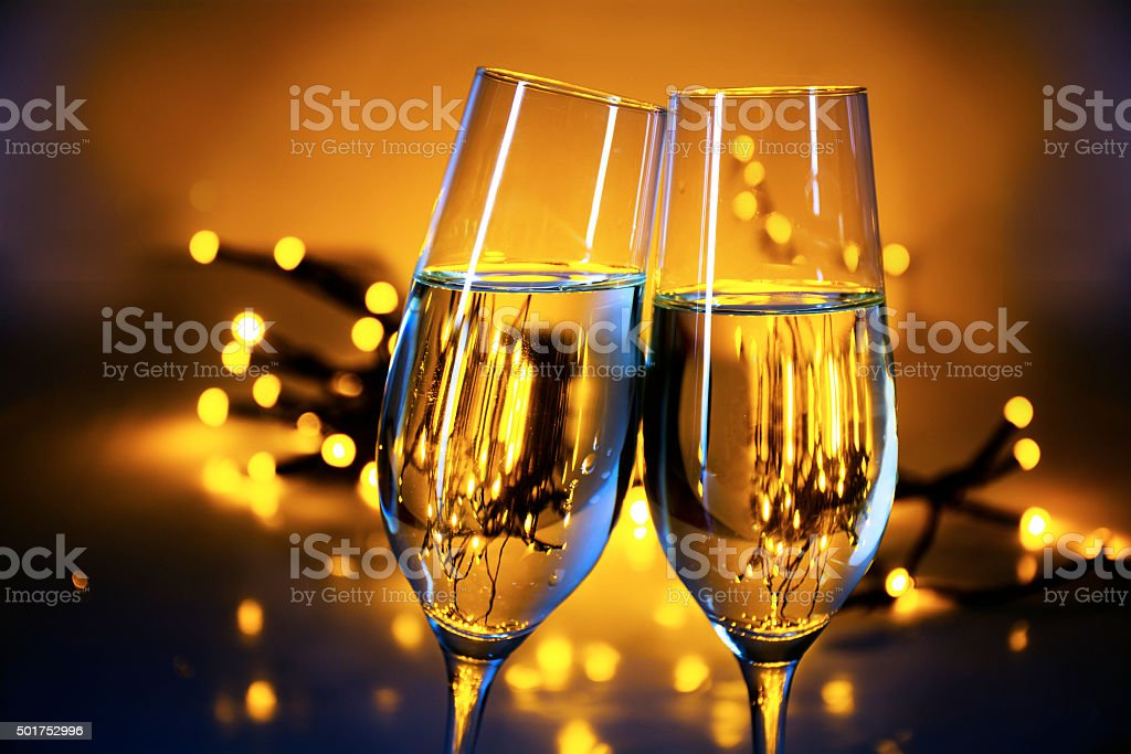 Champagne flutes clink glasses at Christmas or New Year's  party stock photo