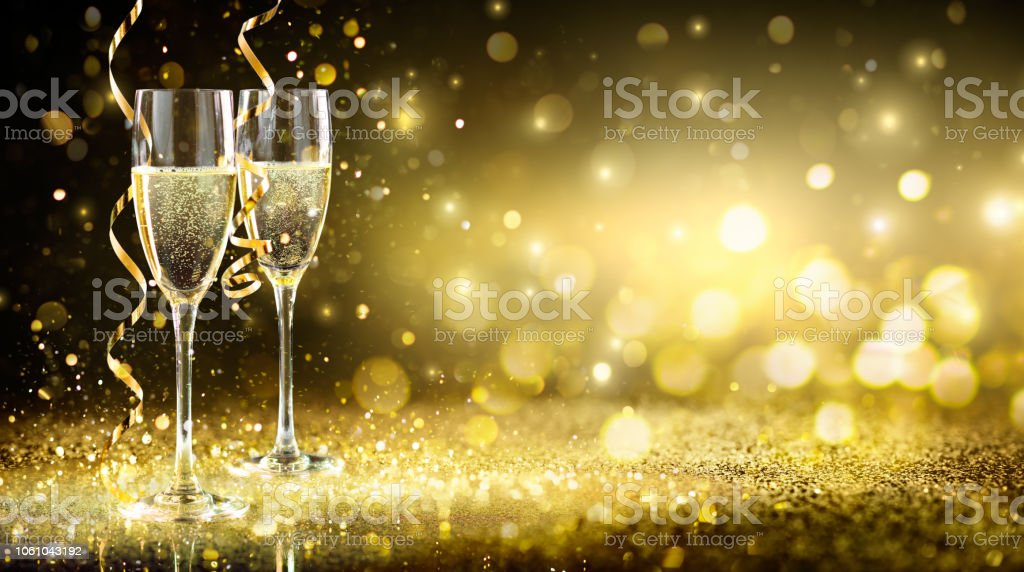Two Champagne Glasses On Glitter