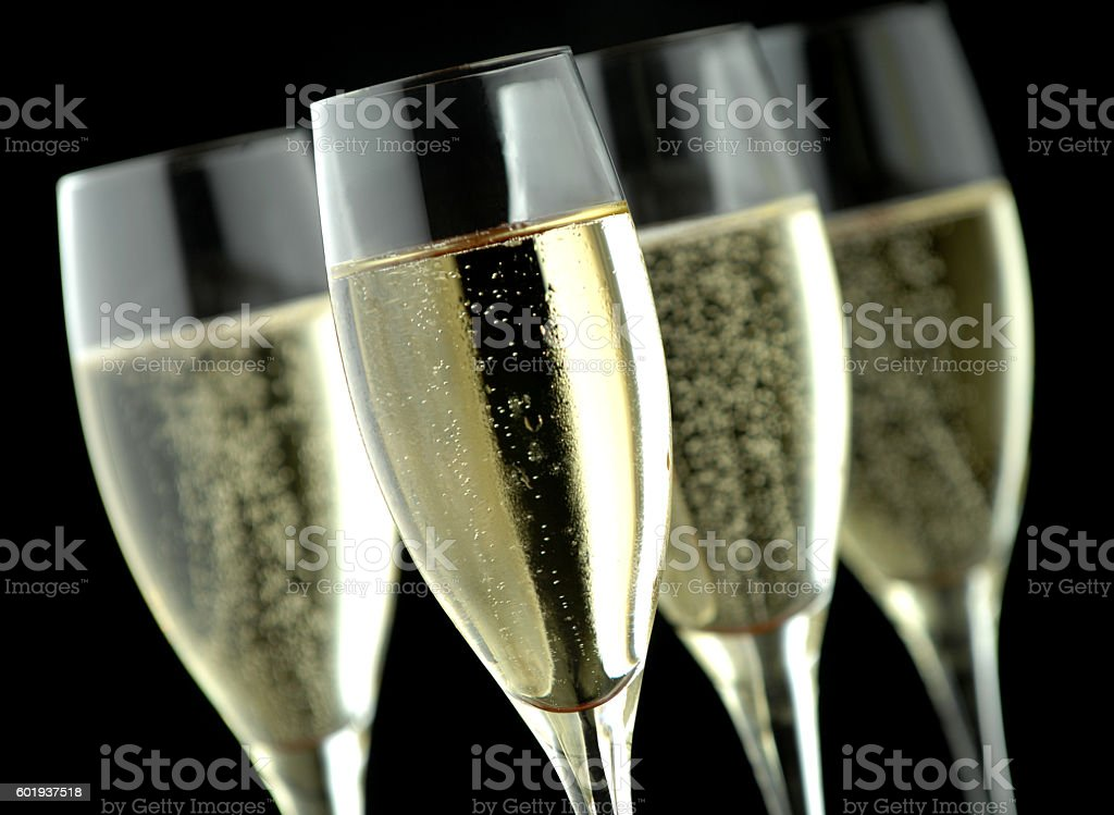 Champagne flutes on black background stock photo