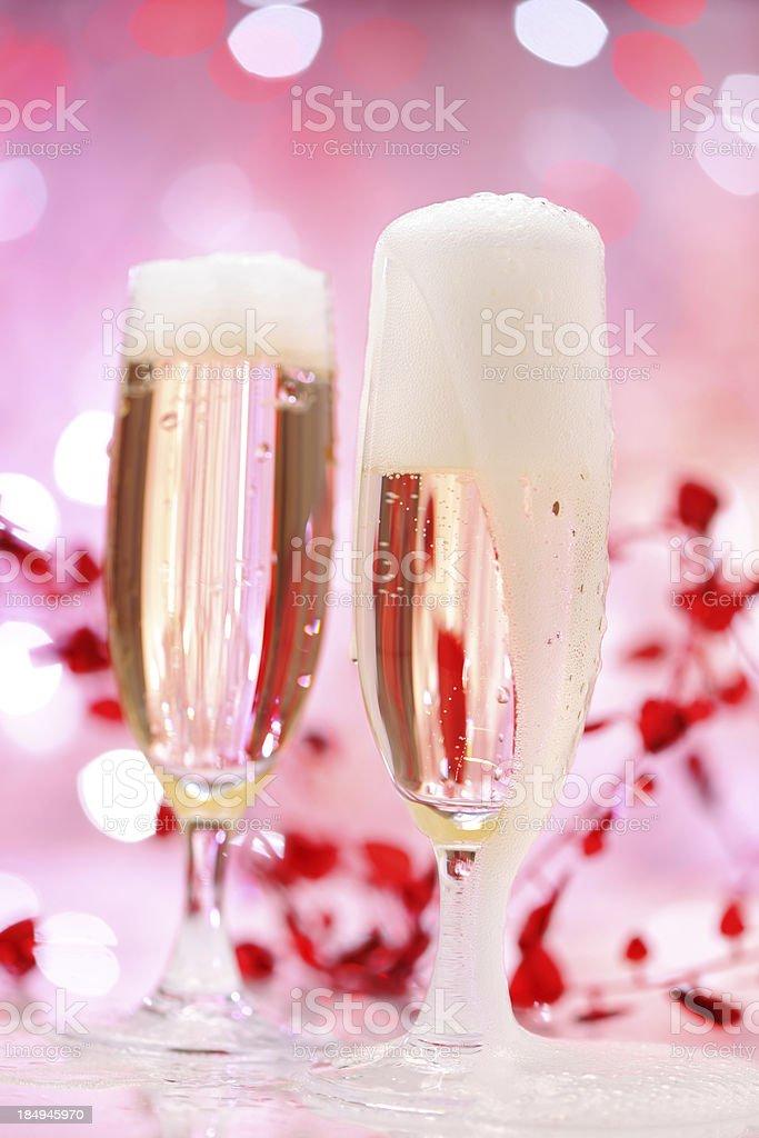 Champagne flutes on illuminated background royalty-free stock photo