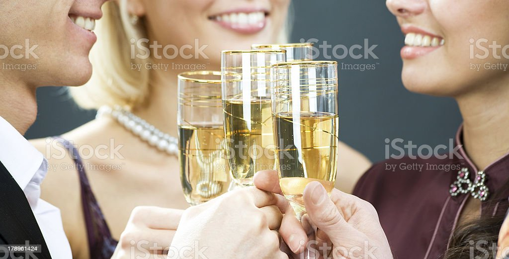 Champagne flutes touching stock photo