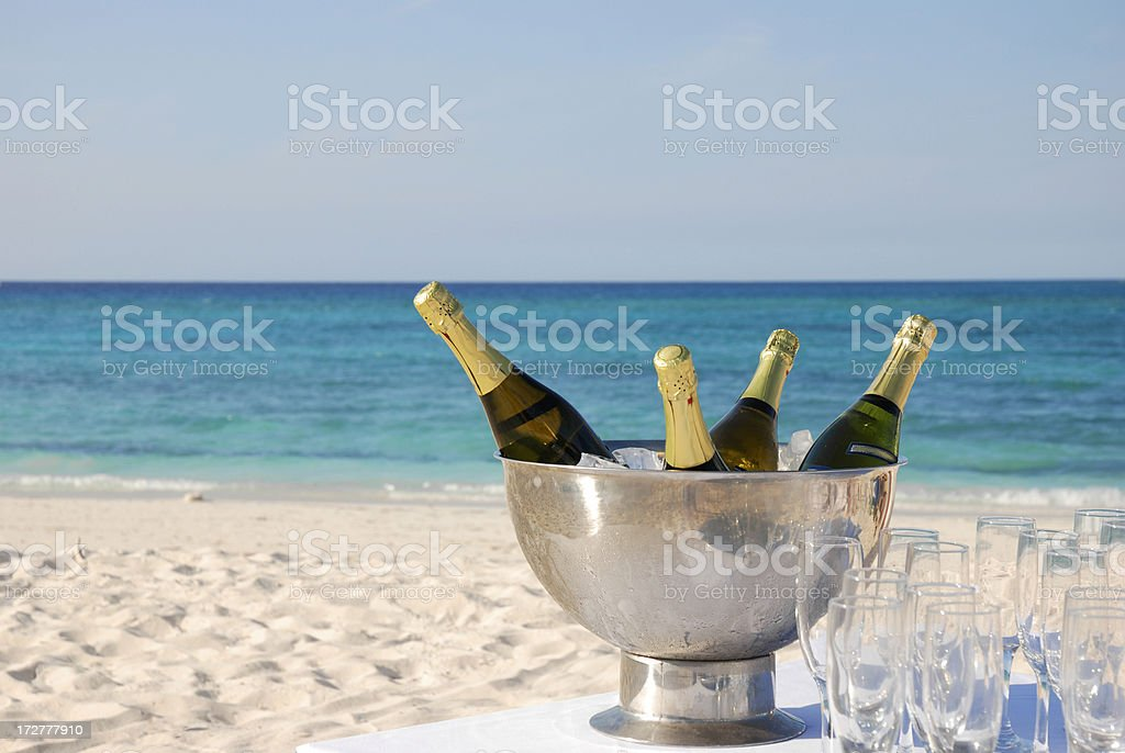 champagne for a celebration on the beach royalty-free stock photo