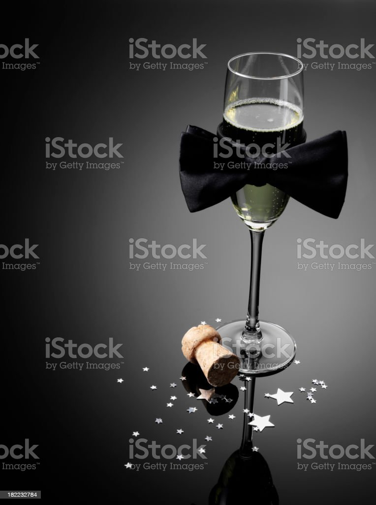 Champagne, Glass and  Black Bow Tie royalty-free stock photo