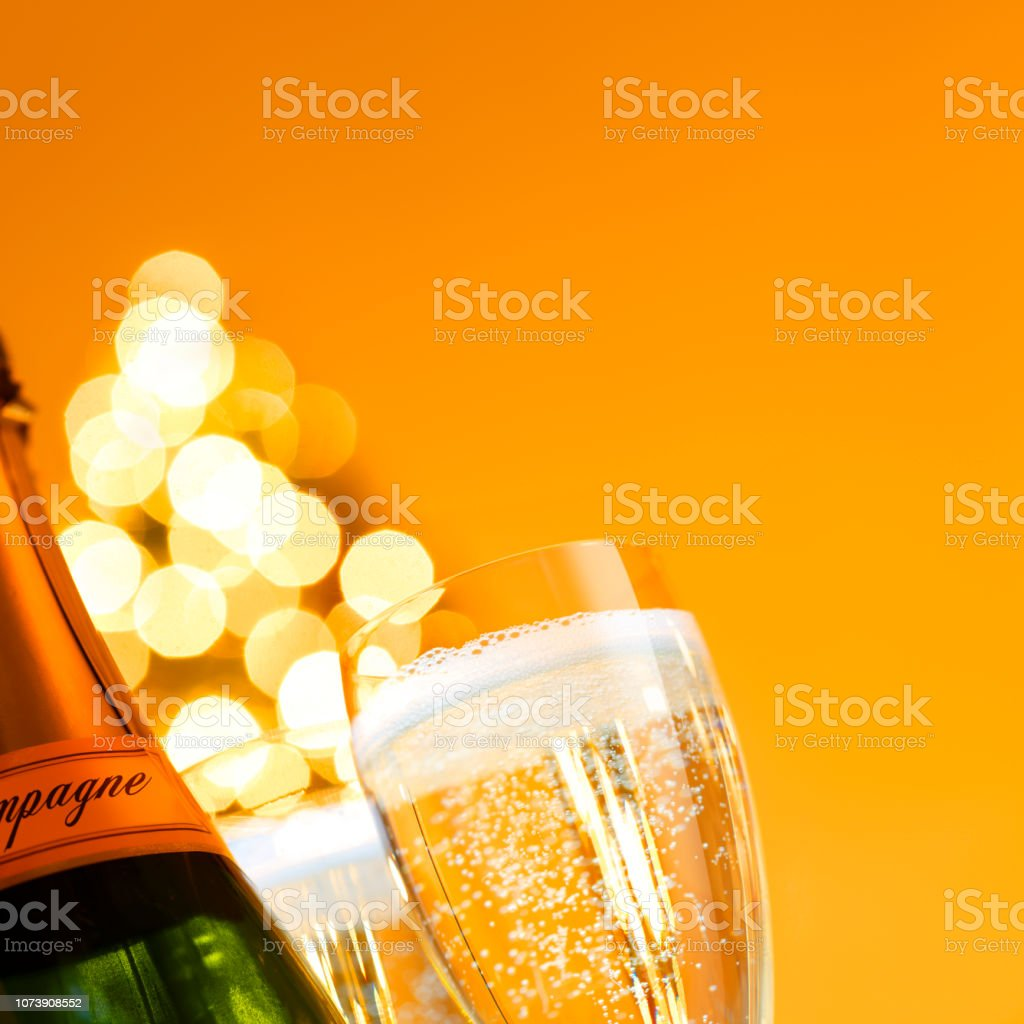Champagne Glass And Bottle In Front Of Christmas Tree stock photo
