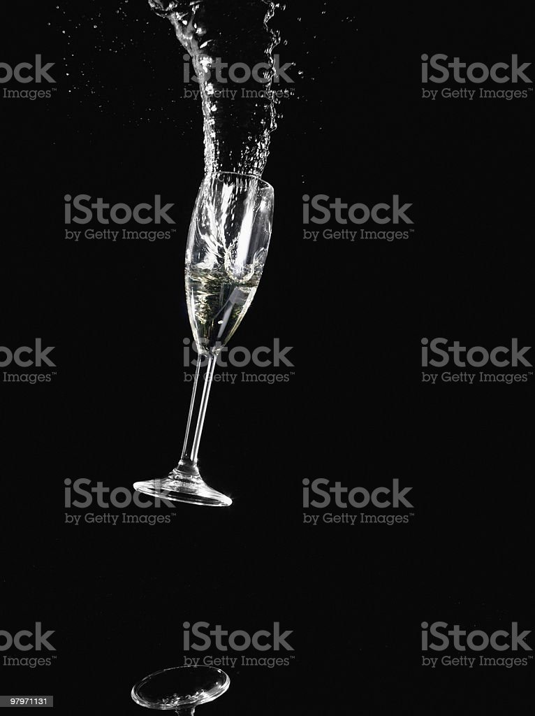 Champagne glass falling and spilling royalty-free stock photo