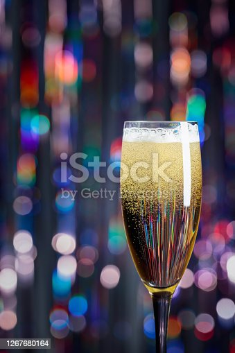 Champagne glass on lights background. Christmas and New Year holidays background. Copy space.