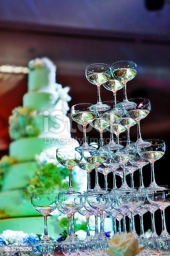 istock Champagne glass tower and wedding cake in wedding ceremony 583728606