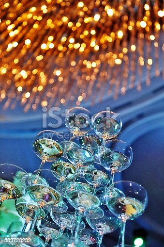 istock Champagne glass tower in wedding ceremony 583728232