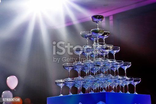 istock Champagne glass tower with spotlight beam in wedding ceremony 578306108