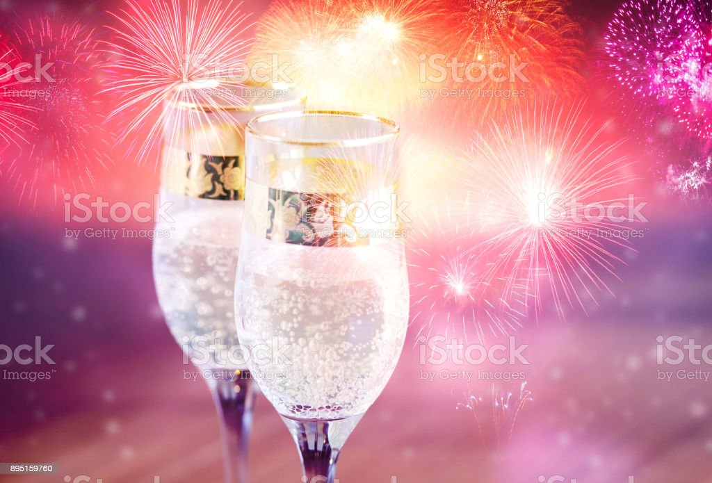 champagne glasses and fireworks new year background royalty free stock photo