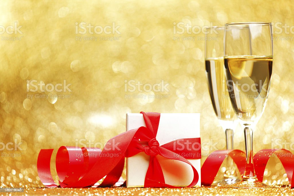 Champagne glasses and gift royalty-free stock photo