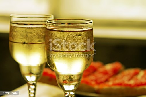 istock Champagne glasses and toasts with caviar 872497442