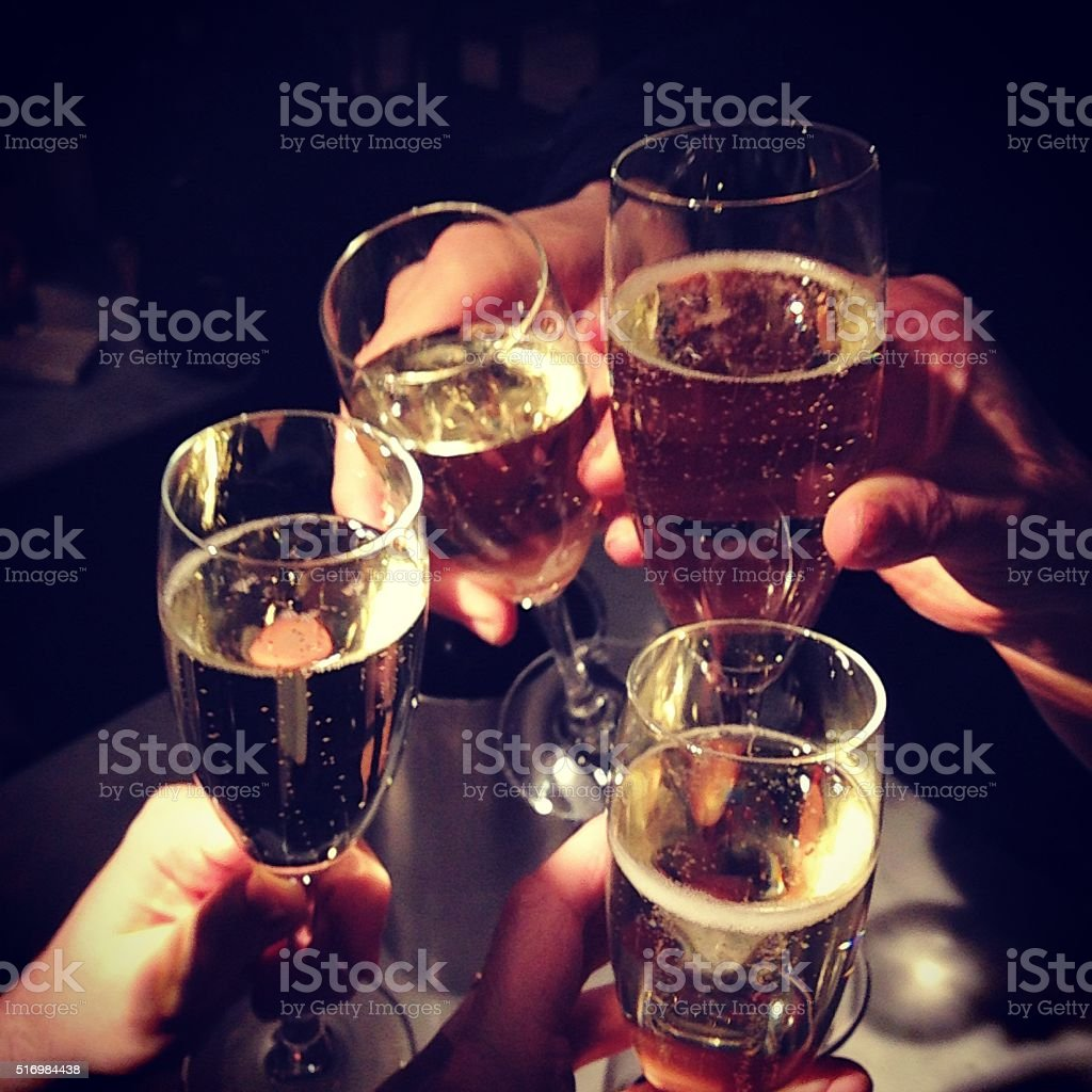 champagne glasses clink toast cheers stock photo
